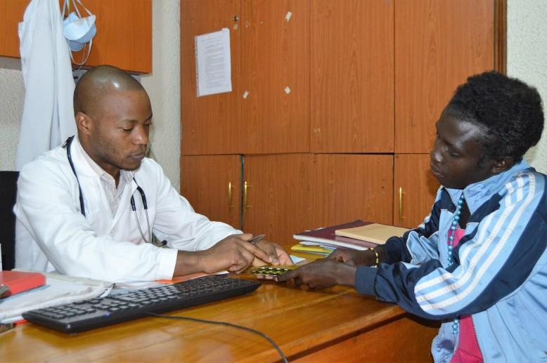 Linda talking to Geoffrey Nsabimana - Clinical officer during her recent appointment at Alive Medical Services